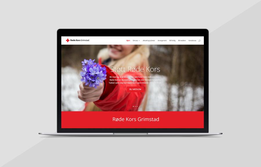 Nettsiden til Røde Kors, vist på en macbook med grå bakgrunn